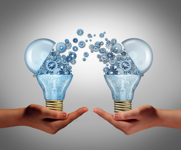 Ideas agreement Investing in business innovation concept and financial commerce backing of creativity as an open lightbulb symbo
